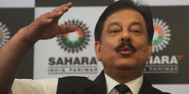 Subrato Roy, chairman of the Sahara Group gestures as he speaks during a news conference in Mumbai on February 4, 2012. Indian cricket was hit by a major crisis on February 4 when the long-time sponsor of the national cricket team pulled out over differences with the board. The Sahara group of companies, which has been a cricket sponsor since 2000, said in a statement that it was ending what it called a 'one-sided emotional relationship' with the Board of Control for Cricket in India (BCCI).  AFP PHOTO/ Punit PARANJPE (Photo credit should read PUNIT PARANJPE/AFP/Getty Images)