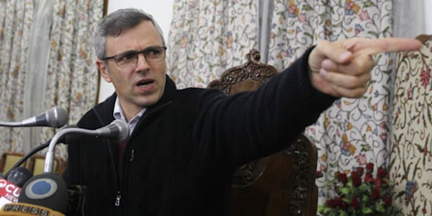 SRINAGAR, INDIA - DECEMBER 22: The Jammu and Kashmir Chief Minister and National Conference leader Omar Abdullah addressing press conference on December 22,2014 in Srinagar, India. As political parties work on strategies and possible alliances in the light of two exit polls projecting a hung house in Jammu and Kashmir, Omar asserted that it was inconceivable for his party to go with the BJP. (Photo by Waseem Andrabi/Hindustan Times via Getty Images)