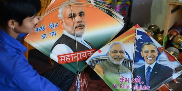 An Indian vendor displays kites printed with the portraits of Prime Minister Narendra Modi and US President Barack Obama, who is expected to visit India for the forthcoming Republic Day celebrations, ahead of the forthcoming Makar Sankranti kite festival in Hyderabad  on January 7, 2015. The Makar Sankranti festival, which will be celebrated on January 14 this year, celebrates the beginning of the harvest season. AFP PHOTO / NOAH SEELAM        (Photo credit should read NOAH SEELAM/AFP/Getty Images)