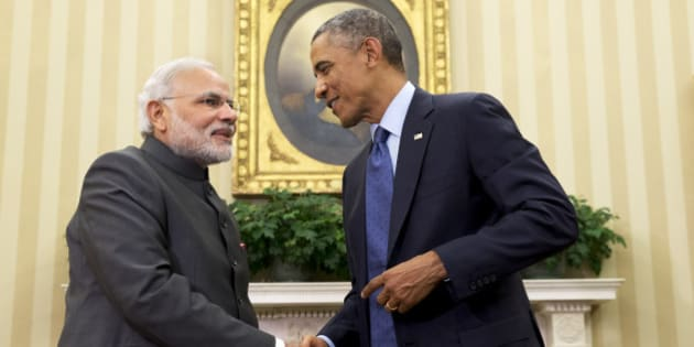 "President Barack Obama shakes hands with Indian Prime Minister Narendra Modi, Tuesday, Sept. 30, 2014, in the Oval Office  of the White House in Washington. President Barack Obama and India's new Prime Minister Narendra Modi said Tuesday that ""it is time to set a new agenda"" between their countries, addressing concerns that the world's two largest democracies have grown apart. (AP Photo/Evan Vucci)"