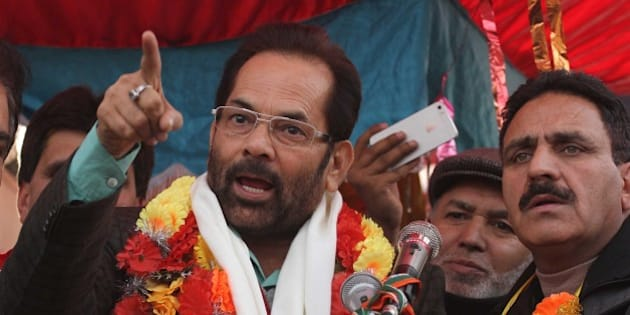 SRINAGAR, INDIA - DECEMBER 12: Bhartiya Janta Party (BJP) leader Mukhtar Abbas Naqvi addressing an election rally at interiors of Dal Lake on December 12, 2014 in Srinagar, India. (Photo by Waseem Andrabi/Hindustan Times via Getty Images)