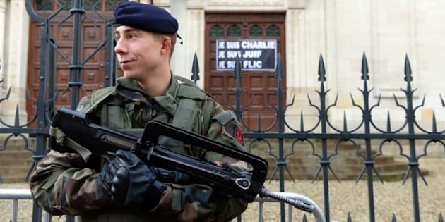 A soldier stands guard outside the main Synagogue in Bordeaux on January 14, 2015.  France announced an unprecedented deployment of thousands of troops and police to bolster security at 'sensitive' sites including Jewish schools on January 12, 2015, a day after marches gathering nearly four million people countrywide.  AFP PHOTO / JEAN PIERRE MULLER        (Photo credit should read JEAN PIERRE MULLER/AFP/Getty Images)