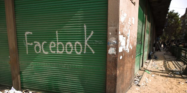 CAIRO, EGYPT - FEBRUARY 04:  A shop in Tahrir Square is spray painted with the word Facebook after the government shut off internet access on February 4, 2011 in Cairo, Egypt. Anti-government protesters have called today 'The day of departure'. Thousands have again gathered in Tahrir Square calling for Egyptian President Hosni Mubarak to step down.  (Photo by Peter Macdiarmid/Getty Images)