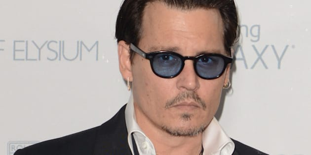 SANTA MONICA, CA - JANUARY 10:  Actor Johnny Depp attends The Art of Elysium 8th Annual Heaven Gala at Hangar 8 on January 10, 2015 in Santa Monica, California.  (Photo by C Flanigan/Getty Images)