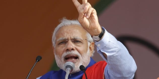 NEW DELHI, INDIA - JANUARY 10: Prime Minister Narendra Modi addresses during the 'Abhinandan rally' at Ramlila Maidan, on January 10, 2015 in New Delhi, India. Modi appeals the people to vote for BJP in large numbers so that it can get a majority in 70-member Delhi Assembly. He said those who believe in anarchy should go to the jungles and ally with Maoists as there is no place for them in the national capital.  (Photo by Virendra Singh Gosain/Hindustan Times via Getty Images)