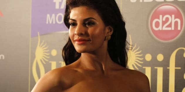 Bollywood actress Jacqueline Fernandez arrives for the International Indian Film Academy (IIFA) awards in Macau, Saturday, July 6, 2013. (AP Photo/Kin Cheung)