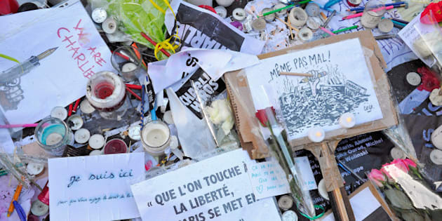 PARIS, FRANCE - JANUARY 14:  Tributes of drawings, flowers, pens and candles are left near the Charlie Hebdo offices on January 14, 2015 in Paris, France. Released today, an initial three million copies of the controversial magazine Charlie Hebdo were printed in the wake of last week's terrorist attacks with an additional two million copies of the magazine scheduled to be printed.  (Photo by Kristy Sparow/Getty Images)
