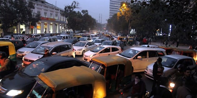 NEW DELHI, INDIA - JANUARY 1: Traffic jam on the first day of New Year eve at Connaught Place, on January 1, 2015 in New Delhi, India. Pubs, restaurants, markets, malls and other popular hotspots in the city were all decked up for New Year celebrations even as security was beefed up and restrictions put in place to thwart any untoward incident. (Photo by Subrata Biswas/Hindustan Times via Getty Images)