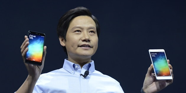 BEIJING, CHINA - JANUARY 15:  (CHINA OUT) Lei Jun, chairman and CEO of China's Xiaomi Inc. presents the company's new product, the Mi Note on January 15, 2015 in Beijing, China. China's leading smartphone maker Xiaomi Inc. presented their new smartphone the 'Mi Note' today, which is expected provide strong competition for the Apple iPhone 6 Plus.  (Photo by ChinaFotoPress/ChinaFotoPress via Getty Images)
