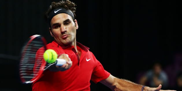 SYDNEY, AUSTRALIA - JANUARY 12:  Roger Federer of Switzerland plays a forehand against Lleyton Hewitt of Australia during their match at Qantas Credit Union Arena on January 12, 2015 in Sydney, Australia.  (Photo by Matt King/Getty Images)