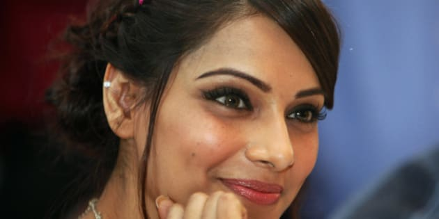 """Bollywood actress Bipasha Basu smiles during a press conference to promote her movie """"Jodi Breakers"""", or """"Pair Breakers"""", in Hyderabad, India, Friday, Feb. 24, 2012. (AP Photo/Mahesh Kumar A.)"""