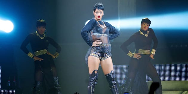 PERTH, AUSTRALIA - SEPTEMBER 24:  Rihanna performs live for fans at the first show of her Australian Tour at Perth Arena on September 24, 2013 in Perth, Australia.  (Photo by Stefan Gosatti/Getty Images)