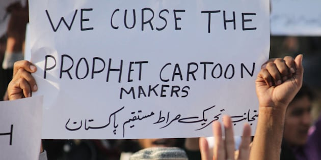 LAHORE, PUNJAB, PAKISTAN - 2015/01/15: Activits of a Pakistani religious Party (Tehreek-e-Siraat-e-Mustaqeem Pakistan) protest against the Satirical French weekly Charlie Hebdo Magazine, publishing of blasphemous sketches of the Prophet Muhammad as the cover of its first edition that caused them attack by Islamist gunmen. Pakistani lawmakers passed a resolution and marched outside parliament to protest the publication of images of Islams prophet and made placards in local language read 'we are ready to die in the name of the Prophet.'. (Photo by Rana Sajid Hussain/Pacific Press/LightRocket via Getty Images)