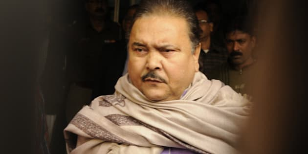 KOLKATA, INDIA - DECEMBER 13: Madan Mitra, West Bengal Transport Minister (Trinamool Congress) being taken to the Alipore court from the CBI office, at Saltlake on December 13, 2014 in Kolkata, India.. He has been arrested in connection with the multi-crore Saradha chit fund scam. Thousands of investors allegedly lost over INR 200-300 billion when Saradha chit fund group collapsed in April 2013. (Photo By Subhankar Chakraborty/Hindustan Times via Getty Images)