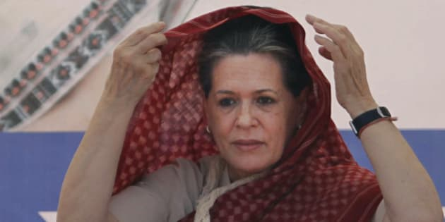 India's ruling Congress party President Sonia Gandhi adjusts the hood of her sari during an election campaign rally for the upcoming Gujarat state Assembly elections at Kalol near Ahmadabad, India, Friday, Dec. 14, 2012. The second phase of polling for the Gujarat state Assembly elections is scheduled to be held on Dec. 17. (AP Photo/Ajit Solanki)