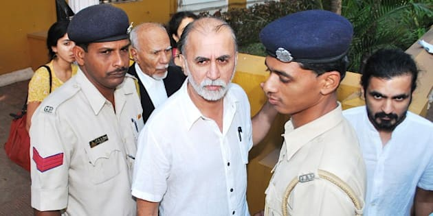 Indian magazine editor Tarun Tejpal (C) is escorted by police officials after a hearing at The High Court in Goa on March 4, 2014.  Tarun Tejpal, the founder and editor of top investigative magazine Tehelka, has been in custody since his arrest in late November 2013,  over an alleged incident of rape in a hotel lift in the southern holiday state -- a case that has scandalised the Indian media.   AFP PHOTO/STR        (Photo credit should read STRDEL/AFP/Getty Images)