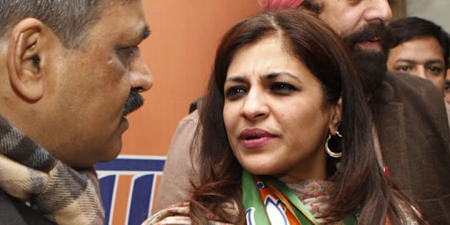 NEW DELHI, INDIA - JANUARY 16: BJP Delhi Pradesh President Satish Upadhyay with former AAP leader Shazia Ilmi after she joined BJP at party office on January 16, 2015 in New Delhi, India. Ilmi had contested and narrowly lost the December 2013 assembly elections on AAP ticket. AAP also fielded her in the Lok Sabha elections of 2014 from Ghaziabad in Uttar Pradesh where she finished a distant fifth. Polling in Delhi will be held on February 7 and the counting of votes will take place on February 10. (Photo by Arvind Yadav/Hindustan Times via Getty Images)