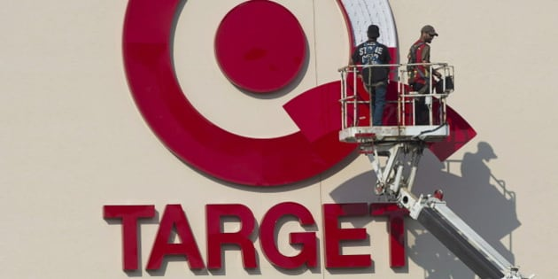 Workers install an outdoor sign at the new Target store at the Mic Mac Mall in Dartmouth, N.S. on July 20, 2013. Target says it will discontinue operating stores in Canada. It currently has 133 locations and 17,600 employees across the country.THE CANADIAN PRESS/Andrew Vaughan