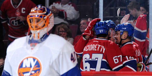MONTREAL, QC - JANUARY 17: Dale Weise #22 of the Montreal Canadiens celebrates his his second period goal with teammates during the NHL game against the New York Islanders at the Bell Centre on January 17, 2015 in Montreal, Quebec, Canada. (Photo by Richard Wolowicz/Getty Images)