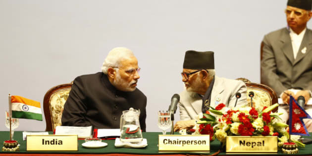 Indian Prime Minister Narendra Modi, left, speaks with Nepalese Prime Minister Sushil Koirala during the 18th summit of the South Asian Association for Regional Cooperation (SAARC) in Katmandu, Nepal, Wednesday, Nov. 26, 2014. The South Asian Association for Regional Cooperation summit, the first since 2011, is meant as a forum to discuss regional issues, but is usually dominated by the rivalry between Pakistan and India. (AP Photo/Narendra Shrestha, Pool)