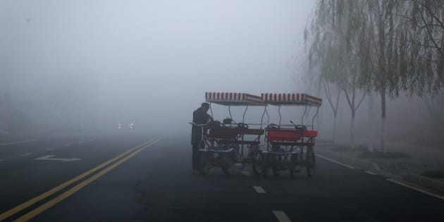 CHANGDE, CHINA - JANUARY 15:  (CHINA OUT) Heavy smog strikes the whole city on early morning with a low visibility on January 15, 2015 in Changde, Hunan province of China. Changde Meteorological Center issued a yellow alert due to the thick smog in the city to draw citizens' attention to transport.  (Photo by ChinaFotoPress/ChinaFotoPress via Getty Images)