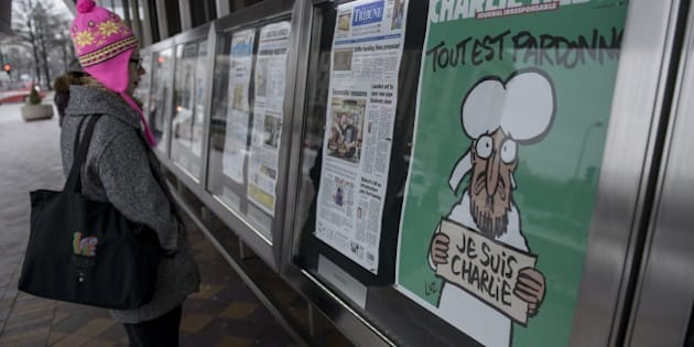 The cover of the French satirical newspaper Charlie Hebdo featuring the Prophet Mohammed is seen displayed with front pages for newspapers from around the world outside the Newseum January 14, 2015 in Washington, DC. French President Francois Hollande proclaimed Wednesday that 'Charlie Hebdo is alive and will live on,' after the satirical weekly published its first edition since Islamist gunmen attacked its Paris offices and killed 12 people. AFP PHOTO/BRENDAN SMIALOWSKI        (Photo credit should read BRENDAN SMIALOWSKI/AFP/Getty Images)
