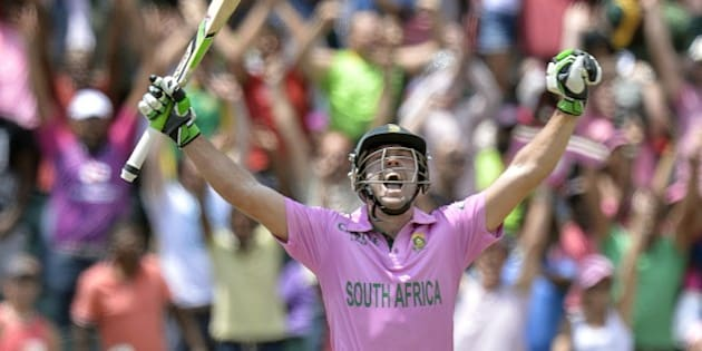 South African batsman AB de Villiers celebrates scoring a century (100 runs) during the second One Day International cricket match between South Africa and the West Indies at Wanderers cricket ground in Johannesburg on January 18, 2015.  AFP PHOTO / STRINGER =RESTRICTED TO EDITORIAL USE=        (Photo credit should read STRINGER/AFP/Getty Images)