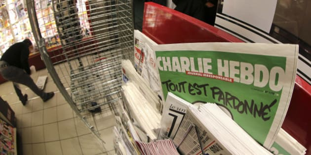 "In this photo made with a fish-eye lens, people wait to buy the latest issue of Charlie Hebdo newspaper at a newsstand in Rennes, western France, Wednesday, Jan. 14, 2015. In an emotional act of defiance, Charlie Hebdo resurrected its irreverent and often provocative newspaper, featuring a caricature of the Prophet Muhammad on the cover that drew immediate criticism and threats of more violence.  The black letters on the front page reads: ""All is forgiven."" (AP Photo/David Vincent)"