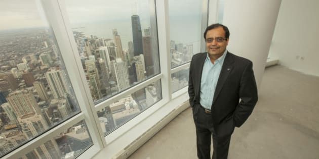Sanjay Shah, founder and CEO of Vistex, Inc., makes history with his purchase of the Trump International Hotel & Tower penthouse on Monday, December 8, 2014 in Chicago. (Photo by Barry Brecheisen/Invision/AP)