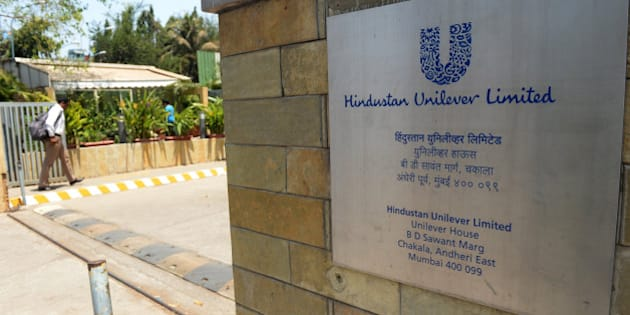 An office-goer enters the premises of Hindustan Unilever Limited in Mumbai on April 30, 2013.  Food giant Unilever on Tuesday announced a 5.4-billion dollar offer to raise its stake in its Indian subsidiary, eyeing explosive sales of branded consumer items to the Asian country's growing middle class.  The Anglo-Dutch firm made an offer to buy another 22.5 percent of already majority-owned Hindustan Unilever (HUL) in a proposed deal that would increase its control to 75 percent.   AFP PHOTO/ INDRANIL MUKHERJEE        (Photo credit should read INDRANIL MUKHERJEE/AFP/Getty Images)