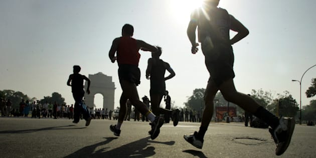 Athletes run during the Delhi half-marathon in New Delhi, India, Sunday, Oct. 16, 2005. Kenyas Phillip Rugut of Kenya, unseen, won the race in one hour, one minute and 55 seconds. Ruguts victory fetched him US$20,000 form the total prize money of US$150,000, which made this race as the worlds richest half-marathon. In the background is the India Gate memorial. (AP Photo/Sebastian John)