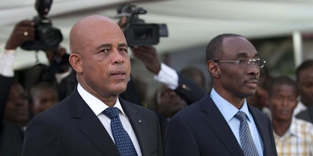 Haitian President Michel Martelly (L) stands with Prime Minister Evans Paul before the speech to the nation at the National Palace in Port-au-Prince on January 16, 2015. During a speech Haiti leader confirmed politician Evans Paul as new prime minister to lead a new government, as he seeks to defuse a crisis over long-delayed elections. AFP PHOTO/Hector RETAMAL        (Photo credit should read HECTOR RETAMAL/AFP/Getty Images)