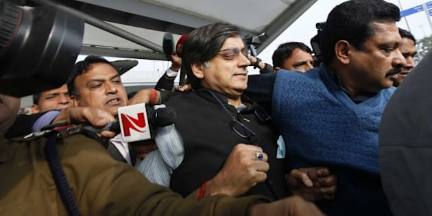 NEW DELHI, INDIA - JANUARY 11: Congress Leader Shashi Tharoor arrives at T3 terminal of IGI Airport after returning from Kerala, on January 11, 2015 in New Delhi, India. Tharoor was undergoing treatment for spondylitis at an Ayurvedic clinic in Kerala. In his first statement to the police days after the death of Sunanda Pushkar, Shashi Tharoor admitted they had had a 'small misunderstanding' but that was 'cleared' and that their married life was 'very happy'. As the probe into the mysterious death of Sunanda Pushkar picks up momentum, Tharoor returned to the capital and asserted it was his duty to cooperate in the investigation. (Photo by Raj K Raj/Hindustan Times via Getty Images)