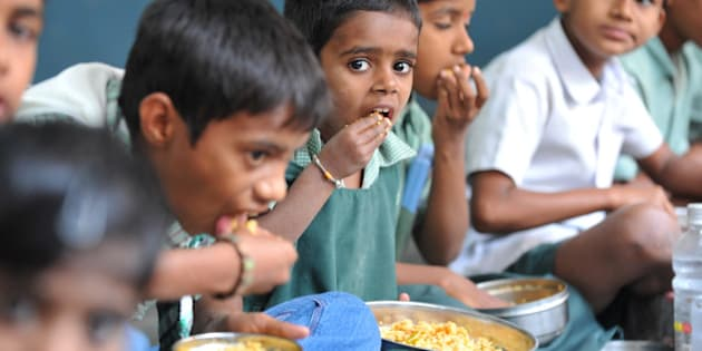 Indian children eat their mid-day meal at an Government High School in Hyderabad, on January 10, 2012. Levels of under-nutrition in the country were 'unacceptably high' despite impressive GDP growth, Prime Minister Manmohan Singh said on January 10, 2012 and added that the problem of malnutrition was a 'national shame'. AFP PHOTO / Noah SEELAM (Photo credit should read NOAH SEELAM/AFP/Getty Images)