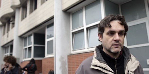 The Charlie Hebdo's cartoonist  Riss is seen in front of the offices of French satirical magazine Charlie Hebdo on November 2, 2011 in Paris after they were destroyed by a petrol bomb attack overnight. The fire at the weekly magazine started around 01.00 am (0200 GMT) and caused no injuries, a police source said. Charlie Hebdo published a special edition on November 2 to mark the Arab Spring, renaming the magazine Charia (Sharia) Hebdo for the occasion, to 'celebrate' the Ennahda Islamist party's election victory in Tunisia and the transitional Libyan executive's statement that Islamic Sharia law would be the country's main source of law. The cover features a cartoon of the prophet, saying: '100 lashes if you don't die of laughter!'.         AFP PHOTO / ALEXANDER KLEIN        (Photo credit should read ALEXANDER KLEIN/AFP/Getty Images)