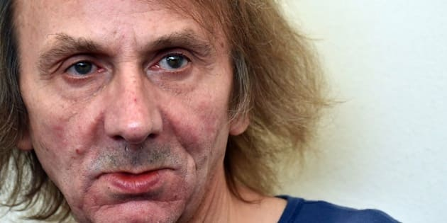 French writer Michel Houellebecq poses during the photocall of the movie 'Near Death Experience' presented in the Orizzonti selection at the 71st Venice Film Festival on September 1st, 2014 at Venice Lido.    AFP PHOTO / GABRIEL BOUYS        (Photo credit should read GABRIEL BOUYS/AFP/Getty Images)