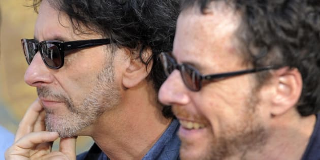"Brothers Joel Coen, left, and Ethan Coen, co-writers and co-directors of the film ""Inside Llewyn Davis,"" look on during a hand and footprint ceremony for cast member John Goodman at the TCL Chinese Theatre on Thursday, Nov. 14, 2013 in Los Angeles. (Photo by Chris Pizzello/Invision/AP)"