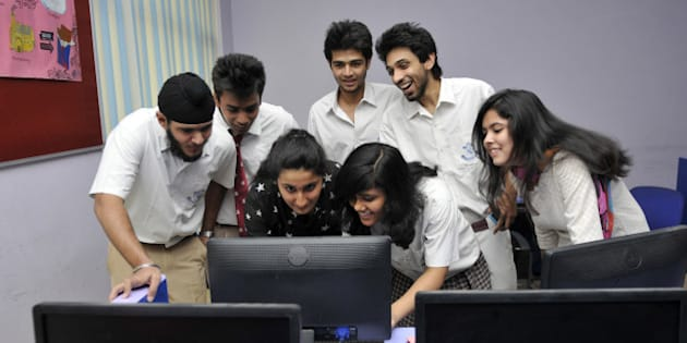 NOIDA, INDIA - MAY 29: Students checking their class XII board exams result on computer screen after it was declared by Central Board of secondary Education on May 29, 2014 in Noida, India. Girls have again outshone boys in the Central Board of Secondary Education Class 12 examinations with pass percentage of 88.52 percent, while boys have a pass percentage of 78.27 percent. The overall pass percentage for 2014 - 82.66 percent - recorded a marginal increase of 0.5 percent over last year 82.10 percent.(Photo by Sunil Ghosh/Hindustan Times via Getty Images)