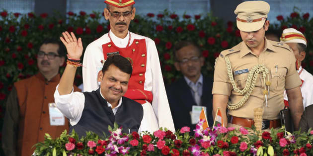 Devendra Fadnavis waves to the crowd after being sworn in as chief minister of Maharashtra state in Mumbai, India, Friday, Oct. 31, 2014. Fadnavis was sworn in as chief minister of the first Bharatiya Janata Party (BJP) government in the state. (AP Photo/Rajanish Kakade)
