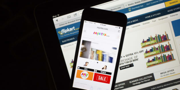 The websites for Flipkart, bottom, and Myntra.com are displayed on an Apple Inc. iPad and iPhone 5c respectively in an arranged photograph in Hong Kong, China, on Wednesday, May 21, 2014. Flipkart, India's largest online retailer, will buy competitor Myntra.com, according to people with knowledge of the talks, to gain a business with higher margins and strengthen its position in the local market against Amazon.com Inc. Photographer: Brent Lewin/Bloomberg via Getty Images