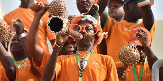 Ivory Coast's supporters cheer ahead of the 2015 African Cup of Nations group D football match between Ivory Coast and Guinea in Malabo on January 20, 2015. AFP PHOTO / ISSOUF SANOGO        (Photo credit should read ISSOUF SANOGO/AFP/Getty Images)