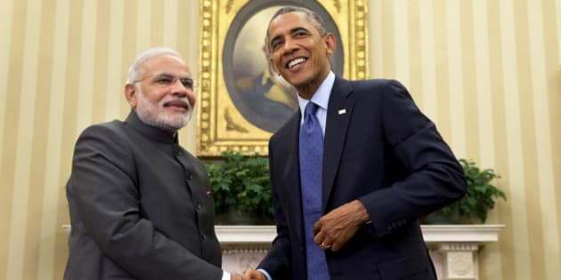 """President Barack Obama shakes hands with Indian Prime Minister Narendra Modi, Tuesday, Sept. 30, 2014, in the Oval Office of the White House in Washington. President Barack Obama and India's new Prime Minister Narendra Modi said Tuesday that """"it is time to set a new agenda"""" between their countries, addressing concerns that the world's two largest democracies have grown apart. (AP Photo/Evan Vucci)"""