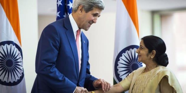U.S. Secretary of State John Kerry greets Indian Foreign Minister Sushma Swaraj in New Delhi, India, Thursday, July 31, 2014. This is Kerry's first visit to India following the resounding election win of Prime Minister Narendra Modi in May. (AP Photo/Lucas Jackson, Pool)