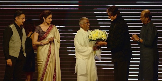 Bollywood film star Amitabh Bachchan (2R) felicitates music director Ilaiyaraaja (C) as film actors Sridevi (2L), Rajinikanth (R) and Kamal Haasan look on during the music launch of new film 'Shamitabh' in Mumbai on January 20, 2015.  'Shamitabh' is scheduled for release on February 6, 2015.  AFP PHOTO / PUNIT PARANJPE        (Photo credit should read PUNIT PARANJPE/AFP/Getty Images)