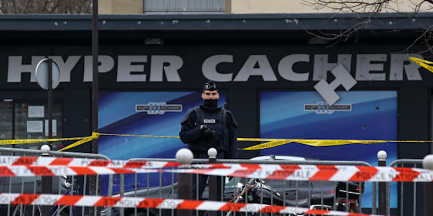 PARIS, FRANCE - JANUARY 10: Police officers guard the kosher market 'Hyper Cacher', which suffered a terrorist attack yesterday, on January 10, 2015 in Paris, France. Four hostages and three suspects were killed when police ended two separate sieges at a kosher supermarket and a printing company on an industrial estate, following Wednesday's deadly attack on 'Charlie Hebdo' french satirical magazine. A fourth suspect, Hayat Boumeddiene, 26, escaped and is wanted in connection with the murder of a policewoman.  (Photo by Marc Piasecki/Getty Images)