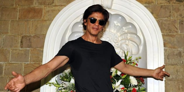 Indian Bollywood actor Shah Rukh Khan poses for a photograph during a photocall for his 49th birthday celebrations at his home in Mumbai on November 2, 2014. AFP PHOTO/STR        (Photo credit should read STRDEL/AFP/Getty Images)