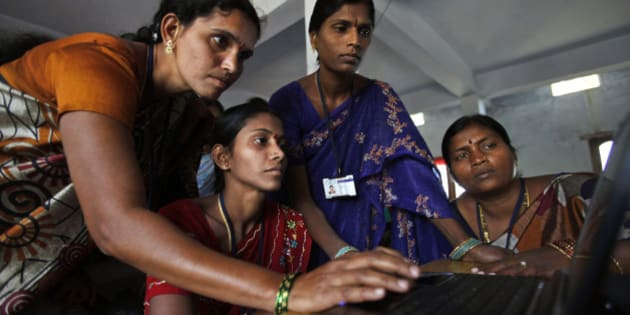 Indian women of Self Help Group (SHG) work on a laptop in Bibinagar village, on the eve of International Women's Day, on the outskirts of Hyderabad, India, Thursday, March 7, 2013.  (AP Photo/Mahesh Kumar A.)