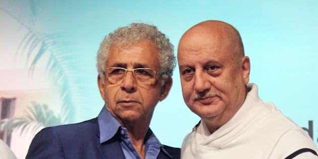 Indian Bollywood film actors Naseeruddin Shah (L) and Anupam Kher pose during the book launch of 'Witnessing Wonders' by journalist Ali Peter John, organized by the Hridayesh Arts in Mumbai on December 28, 2014.   AFP PHOTO        (Photo credit should read STR/AFP/Getty Images)