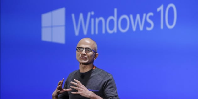 Microsoft CEO Satya Nadella speaks at an event demonstrating the new features of Windows 10 at the company's headquarters Wednesday, Jan. 21, 2015, in Redmond, Wash. Executives demonstrated how they said the new Windows is designed to provide a more consistent experience and a common platform for software apps on different devices, from personal computers to tablets, smartphones and even the company's Xbox gaming console. (AP Photo/Elaine Thompson)