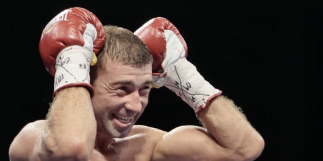 IBF Super Middleweight champion Lucian Bute of Canada reacts after knocking out  Jean-Paul Mendy of France in Bucharest, Romania, Saturday night, July 9, 2011. Bute successfully defended his IBF Super Middleweight title.(AP Photo/Vadim Ghirda)
